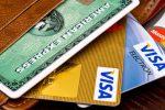 Three Plastic Cards of Visa Mastercard and American Express